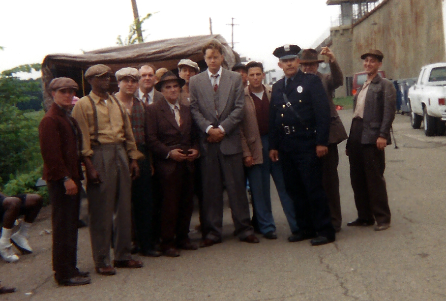 The group of New Fish Cons and actor Tim Robbins between takes.