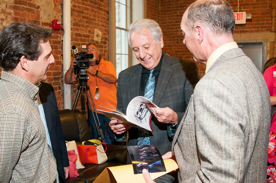 Author Brad Mavis and actor Jodiviah Stepp present actor Bob Gunton (Warden Norton) a copy of <i>Rita the Shawshank Dog</i> at an evening event at the celebration.