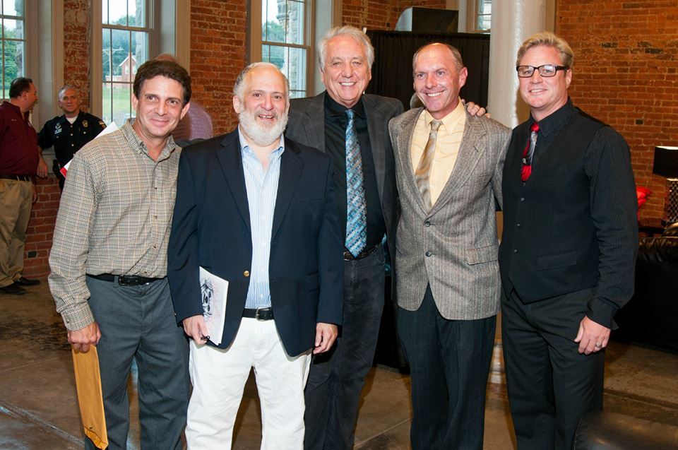 A group photo of actors in <i>The Shawshank Redemption,</i> Author Brad Mavis (New Fish Con), Frank Medrano (Fat Ass), Bob Gunton (Warden Norton), Jodiviah Stepp (New Fish Con) and Scott Mann (murdered lover of Andy Dufresne's wife).